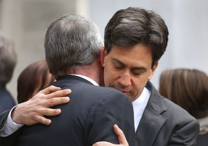 Hilary Benn is hugged by Ed Miliband after the funeral
