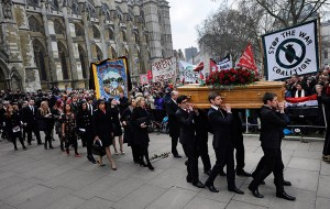 Tony Benn's coffin is carried from St Margaret's Church following his funer